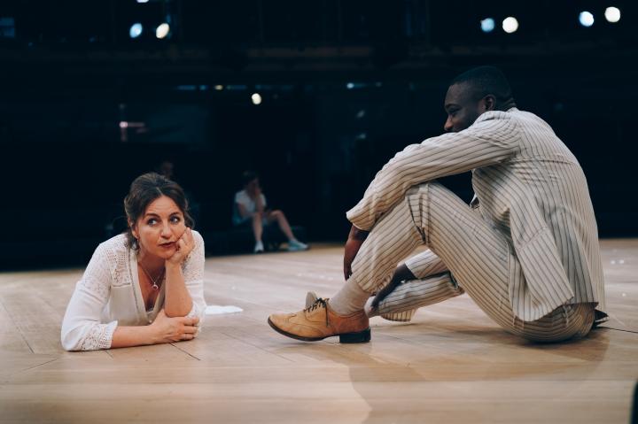 Royal Exchange Theatre - Kirsty Bushell (Lyubov Andreyevna Ranyevskaya) and Jude Owusu (Yermolai Alekseyevich Lopakhin) - The Cherry Orchard. Image by Liam Bennett